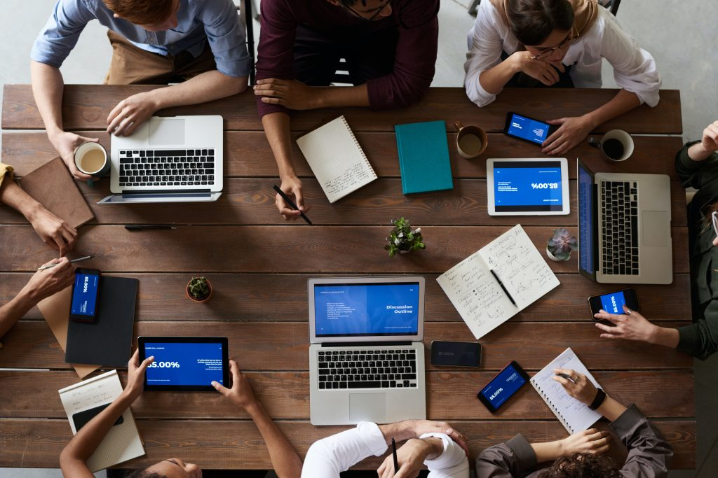 Aerial view of colleagues brainstorming around a meeting table